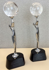 Showcasing the two trophies presented to RBC for the 2014 CoreNet REmmy award wins.