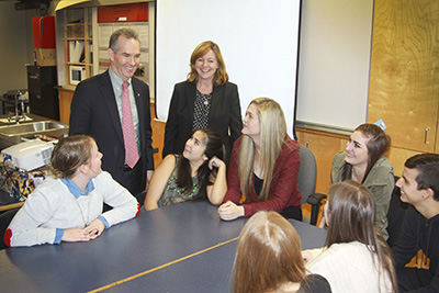 "Surrey, BC – As part of Financial Literacy Month, Graham MacLachlan (RBC Regional President, BC – standing left), Jane Rooney (Canada's Financial Literacy Leader – standing right), teacher Sarah Daintrey (seated left) and students of Clayton Heights Secondary School discuss the ""It All Adds Up"