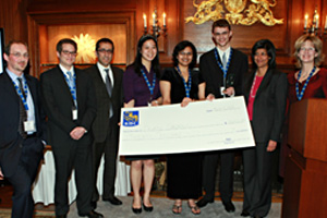 2009/10 winning team, 4th Fibonacci (Schulich School of Business), accept their prize, a cheque for $20,000