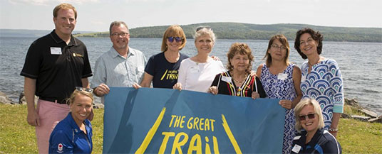 Photo - (L-R): Edward Steeves, Regional Vice President, Private Banking – Atlantic, RBC; Hannah Vaughan, Pan American Games gold medalist, World Cup medalist, RBC Olympian and multi-time national champion kayaker; Blaise MacEachern, Chair of the NS Trails TCT Committee; Valerie Pringle, TCT Foundation Co-Chair; Deborah Apps, TCT President & CEO; Phyllis Googoo, Elder, Waycobah First Nation; Susan Googoo, Director of Human Resources, Entrepreneurship and Skills Development with Waycobah First Nation; Patricia DePalma, Regional Vice-President, Cape Breton and Northeastern Nova Scotia, RBC; Valerie Chort, VP of Corporate Citizenship, RBC.
