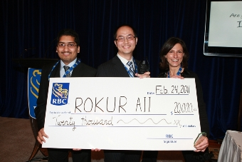 2010/11 winning team, ROKUR AII (University of Waterloo), accept their prize, a cheque for $20,000.